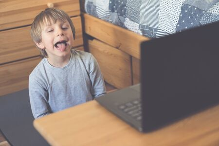 Boy doing speech therapy online