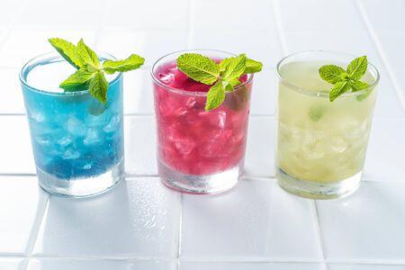 Selection of matcha lemonades - green, blue, red on white background 版權商用圖片