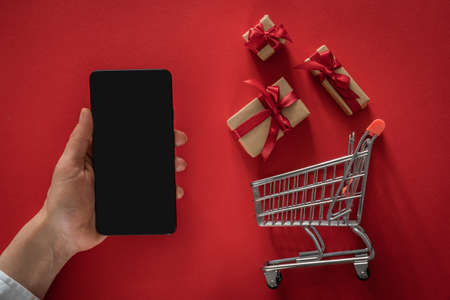 Online shopping for Valentines day concept - presents in shopping cart Banco de Imagens