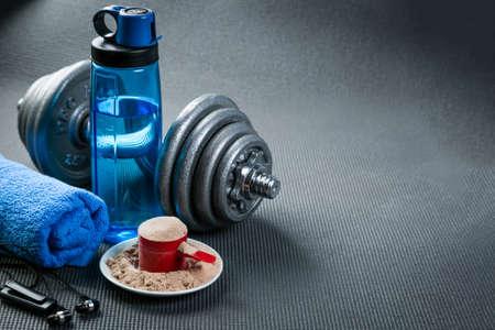 Sport concept - gym supplies on yoga mat background Banco de Imagens