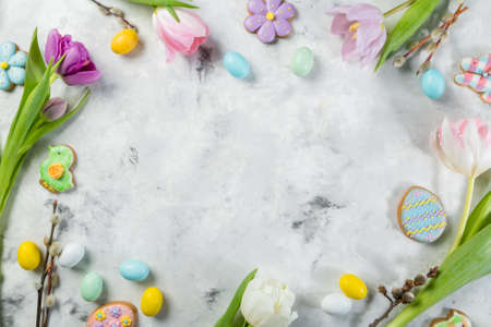 Easter concept - cookies with flowers on marble background