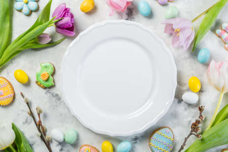 Easter concept - table setting with flowers and cookies