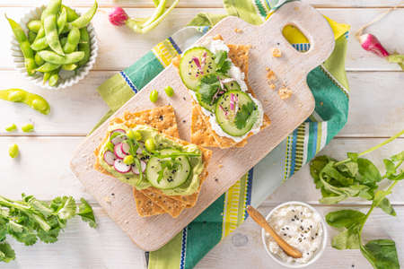 Healthy eating concept - crisp breads with cucumber and raddish on white background Stock fotó