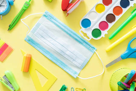 Back to school and covid-19 concept - colorful school supplies