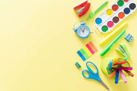Back to school concept - colorful school supplies on bright yellow background Stock fotó