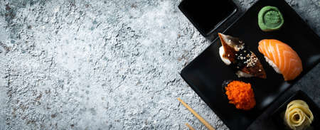 Selection of sushi on rustic background, copy space Stock fotó