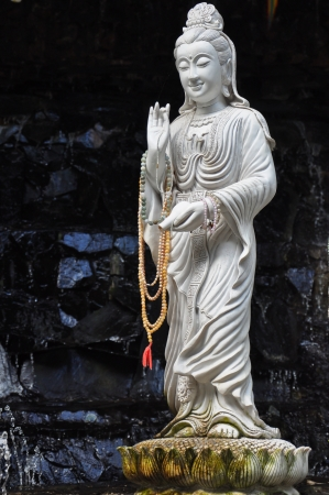 White statue of Guan Yin  photo