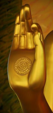 folded hands: Hand of Golden Buddha in meditation
