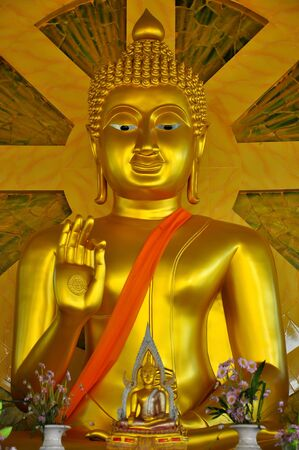 lambent: Golden Buddha in meditation Stock Photo