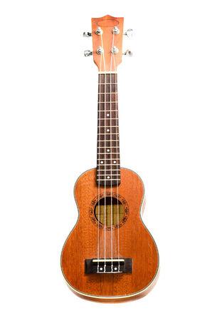 Vintage ukulele on white isolated photo