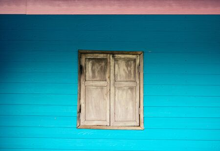 vibrant cottage: window  and blue wall vintage style