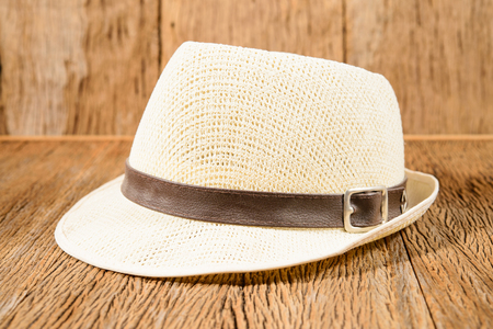 Trendy stylish men hat on wood background photo