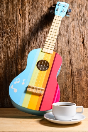 coffee cup with colorful ukulele Imagens