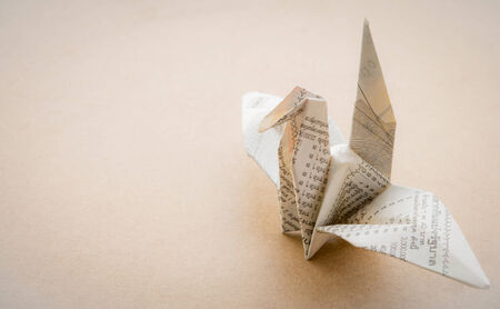 Origami Bird made of Lottery Paper photo