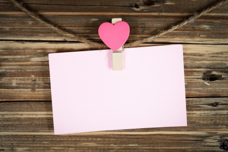 pink paper note on wood background photo