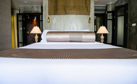 King sized bed in a business hotel room Stock Photo - 24959639