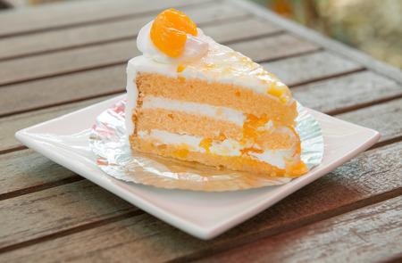 orange cake: orange cake on wood table