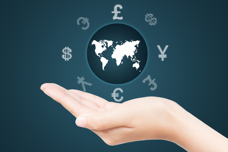 wold map: Money Sign around the wold map on a womans hand