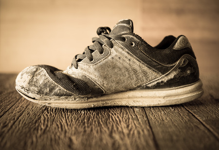 old shoes on wooden floor photo