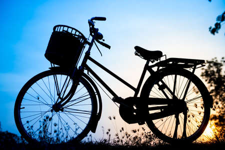 beautiful landscape image with Bicycle silhouette  at blue tone photo