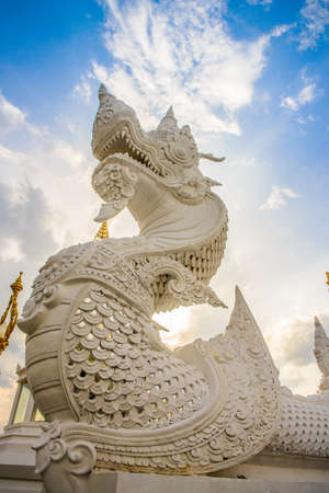 stair well: White naka statue in front of Thai Buddhist pagoda, Khonkaen province, thailand