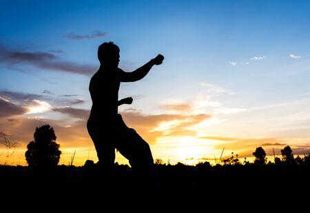 man training kungfu on sunset. photo