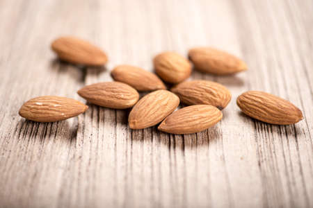 almonds on wood background photo