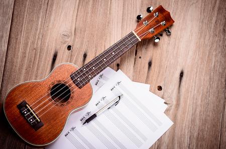 ukelele: Ukulele and musical paper notes Stock Photo