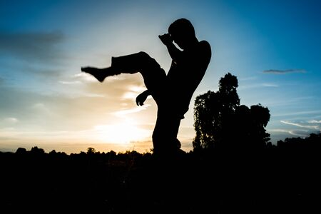 man training karate on sunset. photo