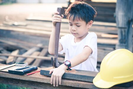 inspector kid: Little engineer ; , concept carpenter in vintage tone style Stock Photo