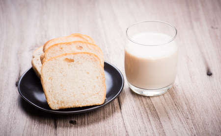 nourish: glass of milk and fresh buns on the table