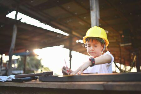 inspector kid: little engineer , concept carpenter Stock Photo