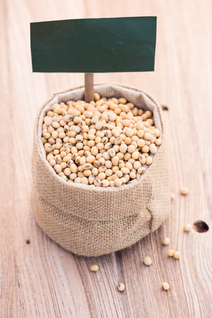 soja: closeup of soybeans in sack with label Stock Photo