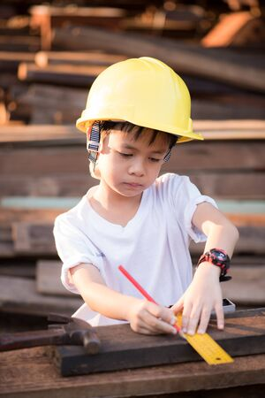 inspector kid: Little engineer ; , concept carpenter