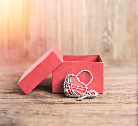 valentin day: Key with the heart and open gift box as a symbol of love valentin es day background;lighting effect vintage style