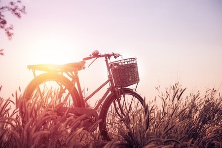 beautiful landscape image with Bicycle  at sunset ; vintage filtered tone style Stock Photo