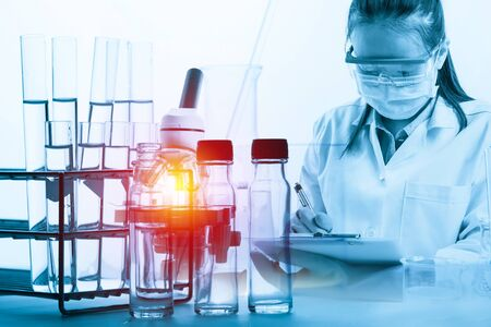 scientist with equipment and science experiments with lighting effect vintage style Imagens