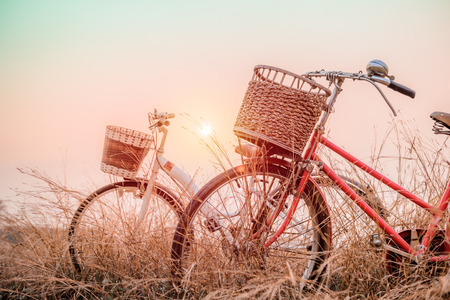 pink bike: beautiful landscape image with two bicycle at sunset ; vintage filter style Stock Photo