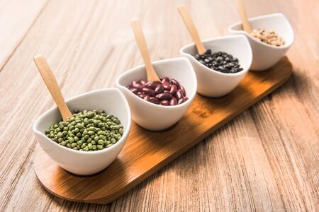 greenbeans: four colored beans  in ceramic bowl selective focus is greenbeans Stock Photo