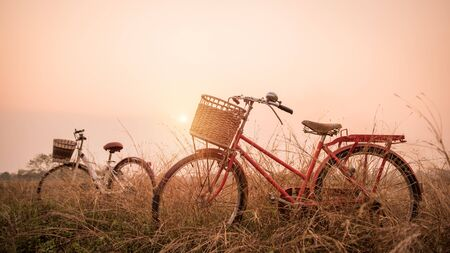 image style: beautiful landscape image with two bicycle at sunset ; vintage filter style Stock Photo