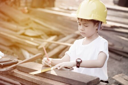 inspector kid: Little engineer concept carpenter ; vintage filtered tone style Stock Photo