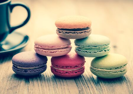 filtered: Colorful French Macarons on wooden background : vintage filtered style