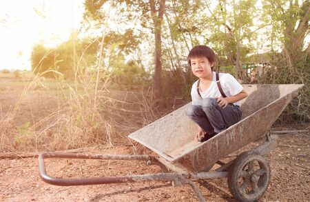 kiddy: Cute Asian boy sit on a cart