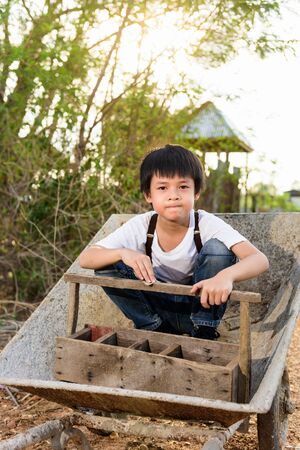 wean: Cute Asian boy sit on a cart