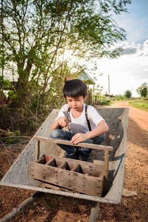 wean: Cute Asian boy playing on a cart