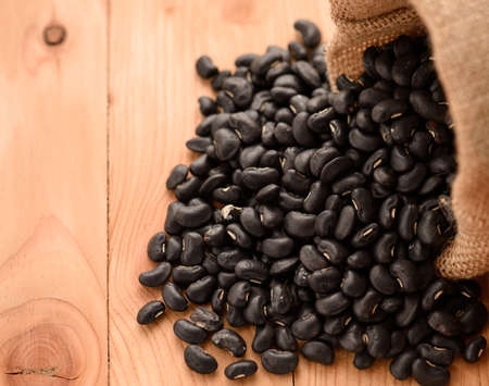 vigna: Vigna mungo or black beans spilling out of a sack Stock Photo