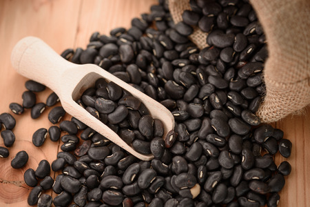 black bean: Vigna mungo or black beans with wooden scoop