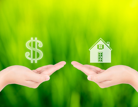 sell house: Hand with icon money and house shape. new house buy concept or sell house Stock Photo