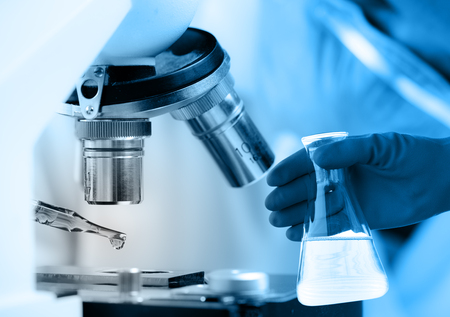 healthcare professional: Scientist  dropping chemical liquid to microscope, Laboratory research concept