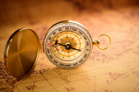 azimuth: Old  gold vintage compass on vintage map Stock Photo